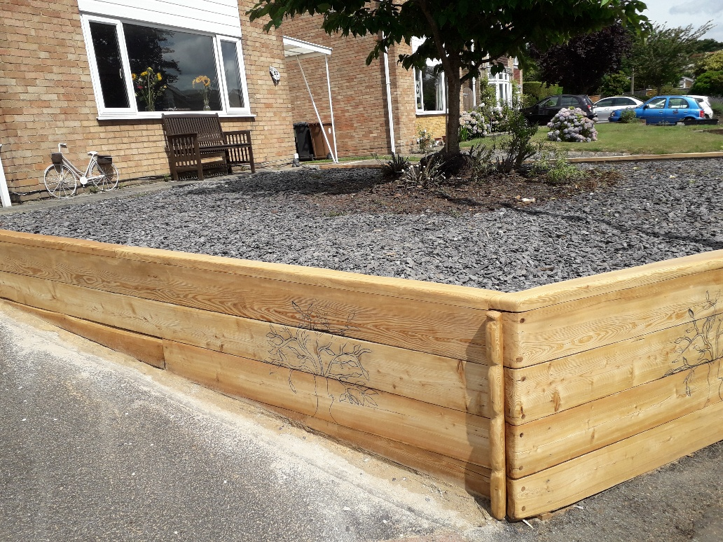 Garden Retaining Wall with Siberian Larch Railway Sleepers
