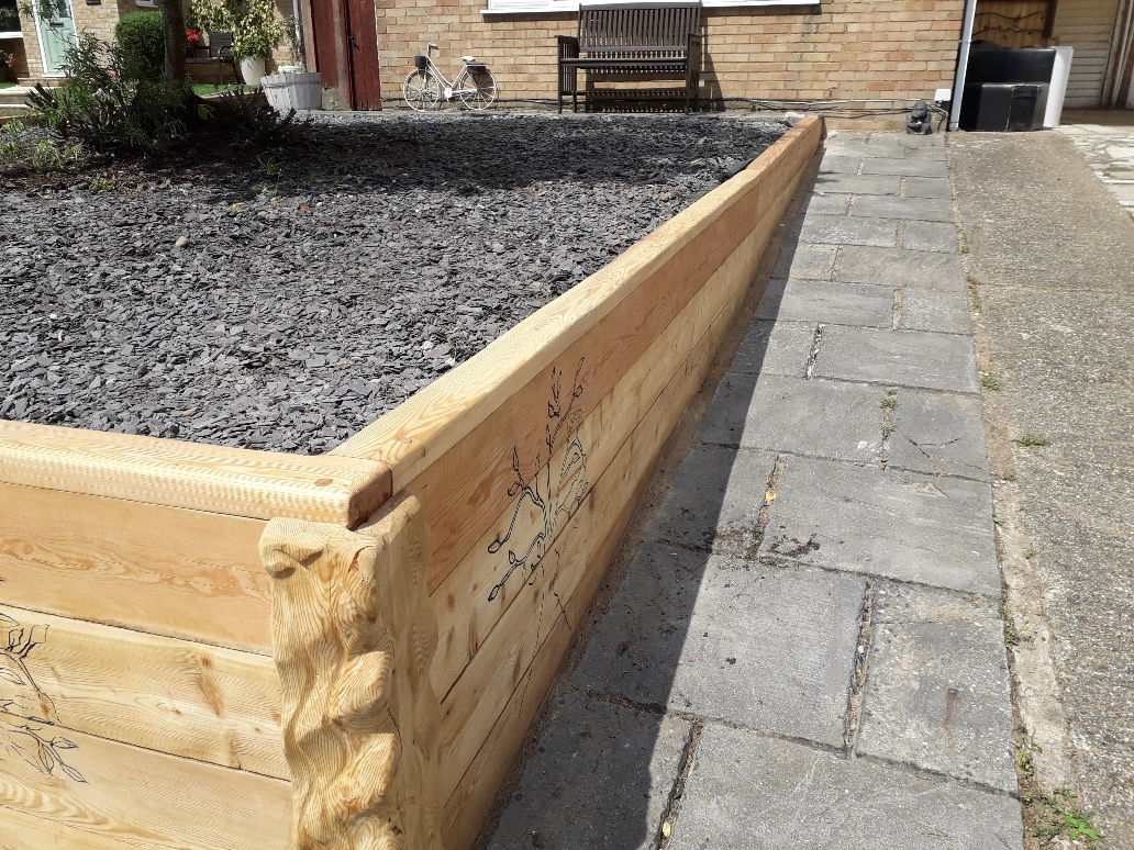 Siberian Larch Railway Sleepers used for a garden Retaining Wall