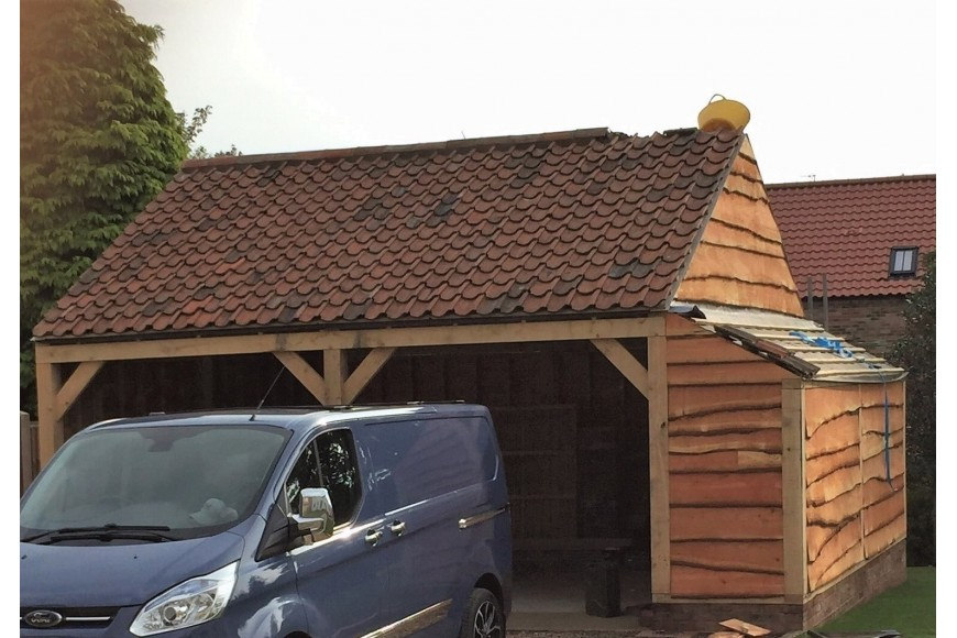 An open garage created with our Structual Oak Beams